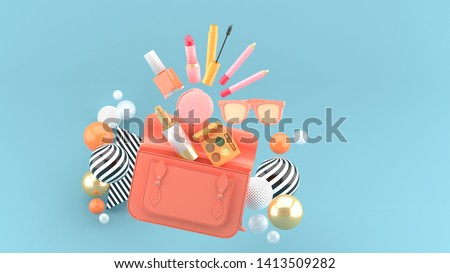 Cosmetics from the handbag surrounded by colorful balls on a blue background.-3d rendering.