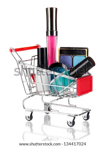 Cosmetics in cart isolated on white
