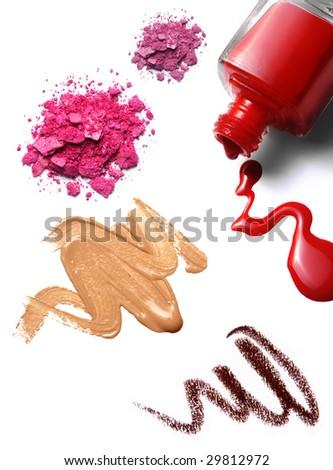 cosmetics: nail polish, foundation, crushed eye shadow. white background, isolated objects