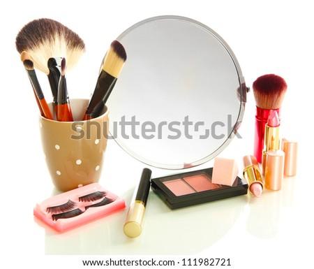 cosmetics near mirror isolated on white - stock photo