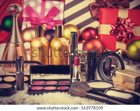 Cosmetics on christmas gifts background