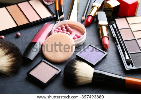 Cosmetics on dark background, closeup #357493880