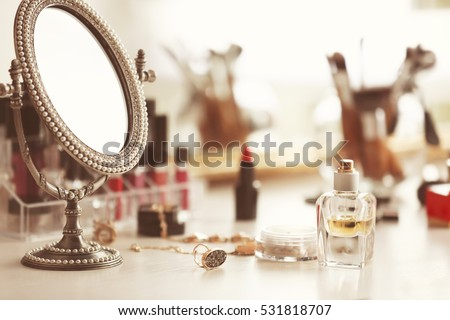 cosmetics on dressing table ...