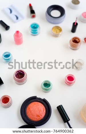 Cosmetics on white background #764900362