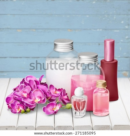 Cosmetics. Pink soap bottles and flowers