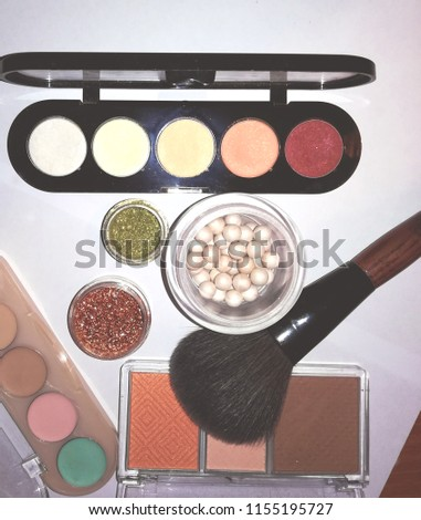 Cosmetics: powder, colorful eyeshadows, blusher at the light background #1155195727