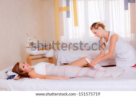 cosmetology. Fat burning body wraps. wrapping method: banding