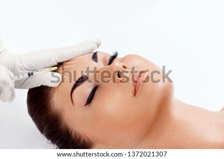 Cosmetology Procedure. Woman Receiving Face Skin Lift Injections. Beauty Injections. Female On Rejuvenation Procedure In Clinic. Plastic surgery. Hand with syringe making injection.Facelift #1372021307