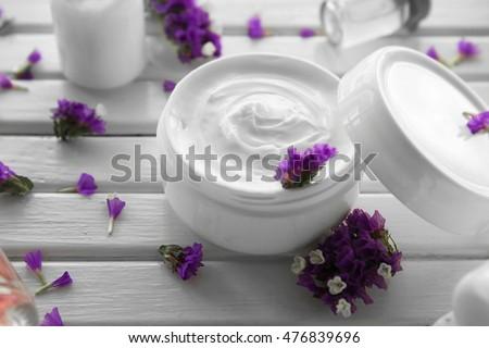 Cosmetology set on white wooden background #476839696