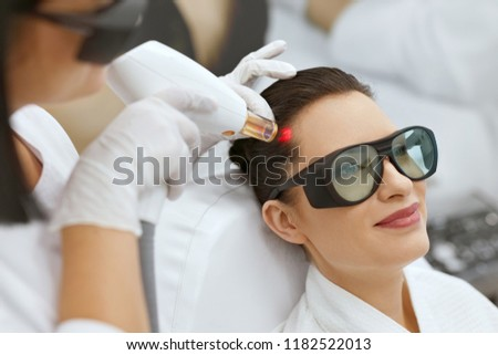 Cosmetology. Woman At Hair Growth Laser Stimulation Treatment #1182522013