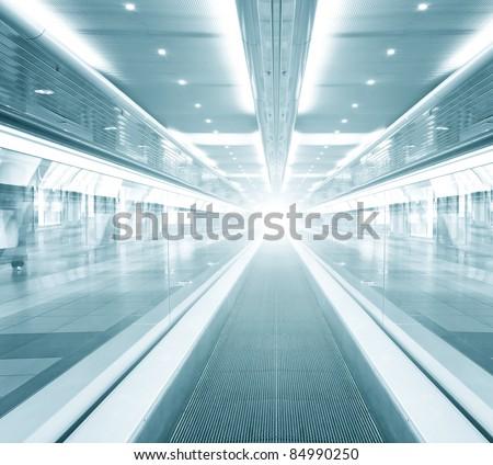 cosmic escalator inside contemporary airport