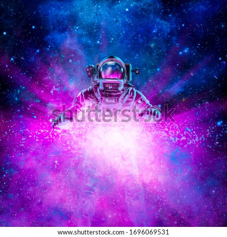 Cosmic light astronaut / 3D illustration of science fiction scene with astronaut lit by exploding galaxy in outer space