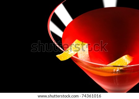 Cosmopolitan cocktail in nice red color in front of a black background