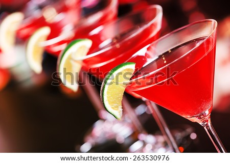 Cosmopolitan cocktail  on a bar counter in a nightclub