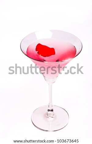 Cosmopolitan cocktail with rose in top of a white background