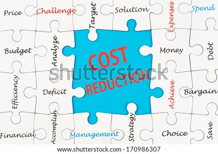 Cost reduction concept word cloud on group of jigsaw puzzle
