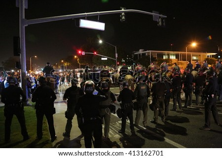 Costa Mesa, CA - April 28, 2016: Protesters of republican presidential candidate Donald Trump, Riot in the streets while the police control the crowd and make arrest  at a rally at the Costa Mesa CA. - Shutterstock ID 413162701
