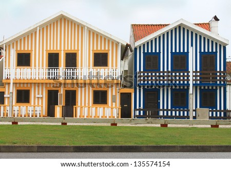 Costa Nova colorful striped fishermen\'s houses in blue and yellow of the Beiras, Portugal, Europe
