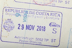 Costa Rica arrival stamp on passport page close up view
