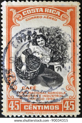 COSTA RICA - CIRCA 1950: A stamp printed in Costa Rica dedicated to agricultural fair, livestock and industrial Carthage, shows a woman picking coffee, circa 1950