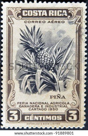 COSTA RICA - CIRCA 1950: A stamp printed in Costa Rica dedicated to agricultural fair, livestock and industrial Carthage, shows a pineapple, circa 1950