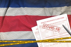 Costa Rica flag and Health insurance claim form with covid-19 stamp. Coronavirus or 2019-nCov virus concept