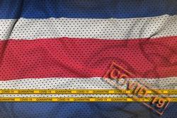 Costa Rica flag and orange Covid-19 stamp with border tape. Coronavirus or 2019-nCov virus concept