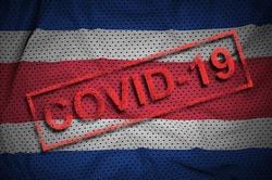 Costa Rica flag and red Covid-19 stamp. Coronavirus 2019-nCov outbreak