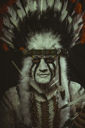 Costume Aboriginal, American Indian with plume of feathers, ax and war paintings