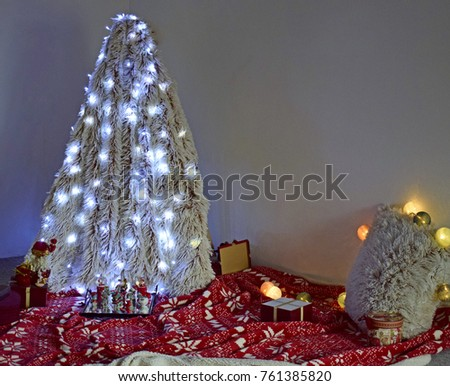 cosy christmas set up with tree made out of blanket