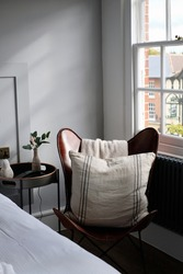 Cosy corner of design led bedroom with an English village view from the window