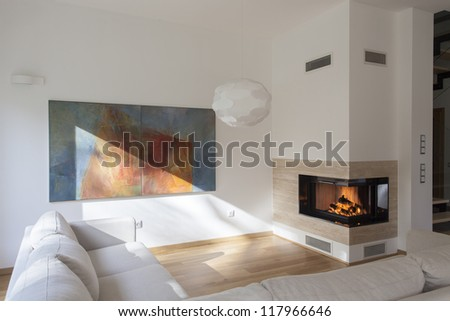 Cosy living room with original painting on wall