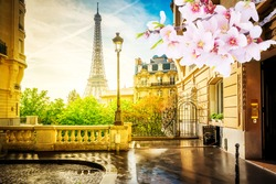 cosy Paris street with view on the famous Eiffel Tower on a cloudy spring day, Paris France