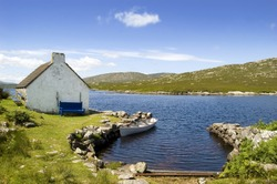 Cottage and boat in Connemara. Ireland