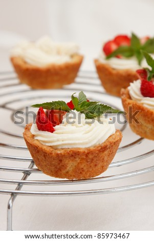 Cottage cheese cream tarts with a slices of strawberry