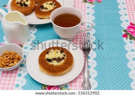 Cottage cheese dessert with tea and salt peanut. #536312902