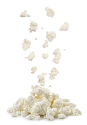 Cottage cheese drops on a heap close-up on a white background. Isolated