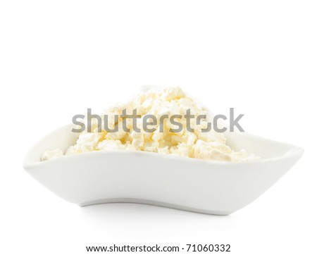 cottage cheese in a dish on a white background