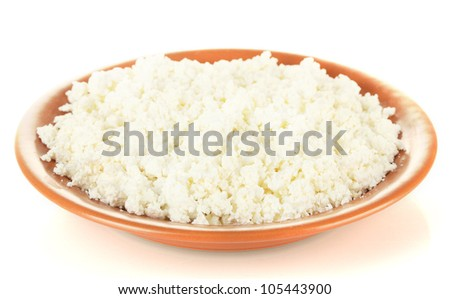 Cottage cheese in a plate isolated on white
