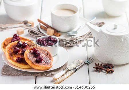 Cottage cheese pancakes with cherry sauce for breakfast on white wooden background #514630255