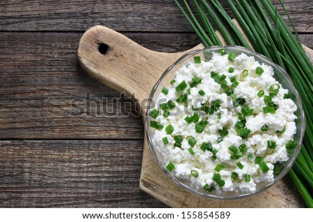 Cottage cheese with chives in glass bowl