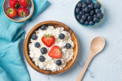 Cottage cheese with strawberry and blueberry, fresh berries, healthy breakfast concept, top view