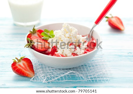 cottage cheese with strawberry sauce and fresh berries