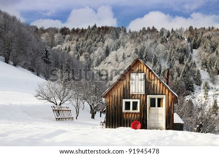 cottage in a beautiful snow forest.