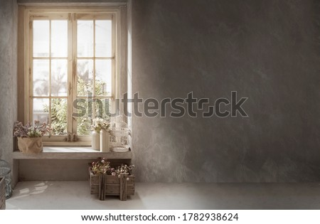 Photo of  cottage vintage decoration with cement wall for retro style background with flower on window shelf