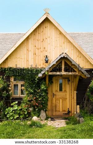 cottage with plants around door