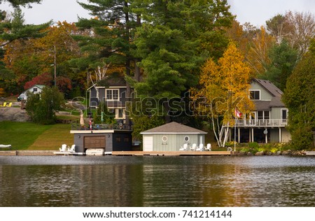 Cottages and boathouses with docks - Shutterstock ID 741214144