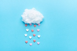 Cotton Ball Cloud Rain Sugar Candy Sprinkle Hearts Red Pink White on Blue Sky Background. Applique Art Composition Kids Style. Valentines Love Charity Concept. Greeting Card Poster Copy Space