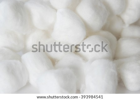 Cotton balls of a kind originally made from raw cotton, used for cleansing wounds, removing cosmetics.