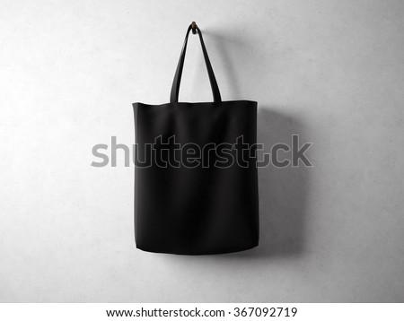 Cotton black textile bag holding, neutral background. 3d render
